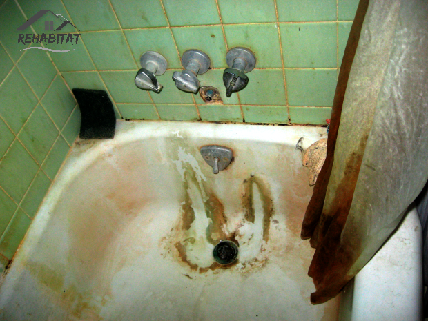 Filthy bathtub; a landlord cleaning up after messy tenants | rehabitathome.com