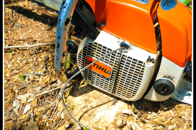 Chainsaw sitting on stump with loose pullstring | rehabitathome.com
