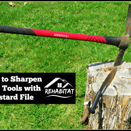 Sharpen your yard tools with a bastard file w/ cutter mattock, kukri on tree stump | rehabitathome.com