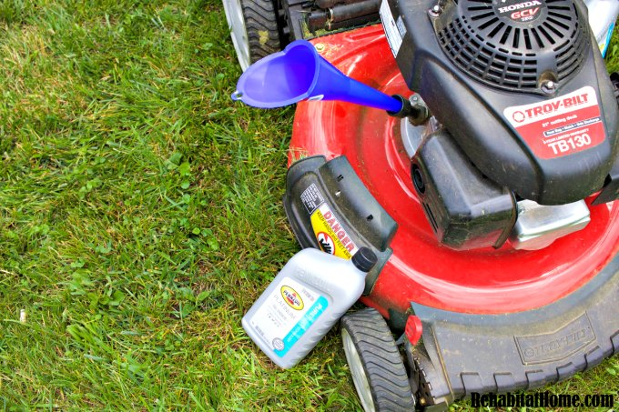 Adding oil to the lawn mower to improve performance