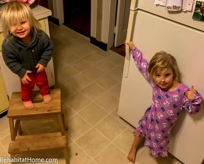 Daughters ready to help dad prepare and cook dinner! Younger daughter standing atop ikea ladder stool and older daughter ready to open the refrigerator for ingredients. Find the stool here: http://amzn.to/2iUOfvL