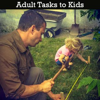 The Participation Effect: introducing adult tasks to kids discusses how our family installs the skills necessary for small children to understand the complex jobs that mom and dad do around the house. Help demystify parental jobs to build confidence and encourage young ones to help with big jobs. Image features a father and daughter measuring a distance between two stakes with a tape measure stretched between them. Father is holding a hand while daughter squats on the grass and holds the tape tight. A dump cart with dirt sifter can be seen in the background.