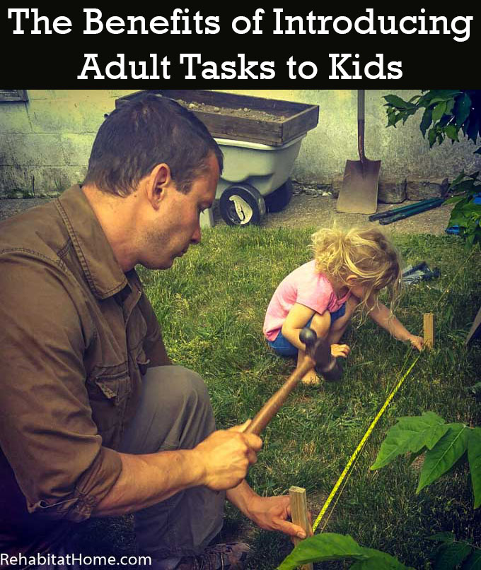 The Participation Effect: introducing adult tasks to kids discusses how our family installs the skills necessary for small children to understand the complex jobs that mom and dad do around the house. Help demystify parental jobs to build confidence and encourage young ones to help with big jobs. Image features a father and daughter measuring a distance between two stakes with a tape measure stretched between them. Father is holding a hand while daughter squats on the grass and holds the tape tight. A dump cart, shovel, clippers, gloves and dirt sifter can be seen in the background.