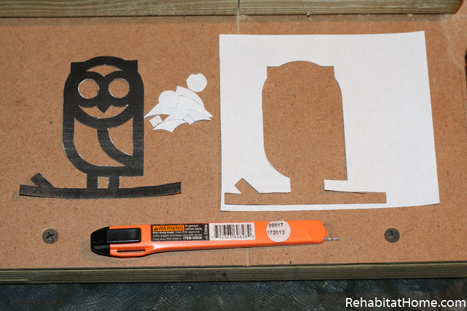 Create your own DIY wood animal toys by finding and printing animal shapes online. Black and white owl icon image printed on white paper next to an exacto razor blade. Learn more at rehabitathome.com.
