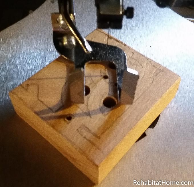 Create your own DIY wood animal toys by finding and printing animal shapes online. Owl is being cut out on the scroll saw after holes were drilled using the drill press. Saw blade is passing through hole in wood for internal cut. Learn more at rehabitathome.com.